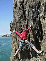 Lead climbing outside on the great sea cliffs of Gogarth
